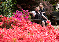BNPS.co.uk (01202) 558833. <br /> Pic: CorinMesser/BNPS<br /> <br /> With video - download: https://we.tl/t-5zrzRIzI4L<br /> <br /> Pictured: Dawn and Terry Heaver in their Japanese-themed garden. <br /> <br /> A green-fingered couple who have spent 20 years building an incredible Japanese-themed garden behind their bungalow home are now preparing to show it off to the public. <br /> <br /> Dawn and Terry Heaver, who say they have never even visited Japan, began cultivating the three-quarter-acre plot after being inspired by a visit to a nearby botanical gardens.<br /> <br /> Their secluded garden in the village of St Ives, Dorset, is now enclosed by evergreen trees and features a waterfall, an ornamental 5,000sq ft lake, two shinto torii gates, an Oriental pergoda and Japanese stone ornaments including a tiered tower and foo dogs.