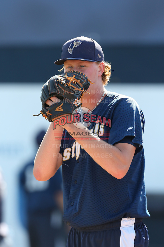 Trey Wingenter (15) of the Tri-City Dust Devils works in the bullpen before a game against the Vancouver Canadians at Nat Bailey Stadium on July 23, 2015 in Vancouver, British Columbia. Tri-City defeated Vancouver, 6-4. (Larry Goren/Four Seam Images)