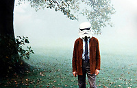 BNPS.co.uk (01202 558833)<br /> Pic: PropStore/BNPS<br /> <br /> Landowner Capt Richard Hawkins trys the helmet on for size at the event in rural Northamptonshire in 1978.<br /> <br /> A Stormtrooper helmet from the first Star Wars film has sold for almost £200,000 by a relative of a British country squire.<br /> <br /> Captain Robert Hawkins and his wife Anne were gifted the iconic helmet for staging the Star Wars Cross Country Team Event at their English manor house in 1978.<br /> <br /> The bizarre equestrian event was attended by Carrie Fisher, who played Princess Leia, Darth Vader actor David Prowse, Peter Mayhew, who played Chewbacca, and football pundit Jimmy Hill.