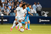 KANSAS CITY, KS - MAY 29: Gianluca Busio #10 Sporting KC with the ball during a game between Houston Dynamo and Sporting Kansas City at Children's Mercy Park on May 29, 2021 in Kansas City, Kansas.