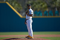 Kennesaw State Owls relief pitcher Malik Spratling (3) looks to his catcher for the sign against the Western Carolina Catamounts at Springs Brooks Stadium on February 22, 2020 in Conway, South Carolina. The Owls defeated the Catamounts 12-0.  (Brian Westerholt/Four Seam Images)