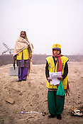 Vaccinators, Murti Devi (45) and Pooja (19) pose for a photograph while doing a house to house polio vaccination at a construction site in Ghaziabad, Uttar Pradesh, India.