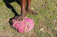 MADAGASCAR, canal des Pangalanes, village ANILAVINARY, girls play football with selfmade ball from garbage / MADAGASKAR, canal des Pangalanes, Fischerdorf ANILAVINARY, Maedchen spielen Fussball mit selbstgemachtem Ball aus Abfall