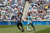 ST PAUL, MN - JULY 18: Chase Gasper #77 of Minnesota United FC and Kelyn Rowe #22 of the Seattle Sounders FC during a game between Seattle Sounders FC and Minnesota United FC at Allianz Field on July 18, 2021 in St Paul, Minnesota.