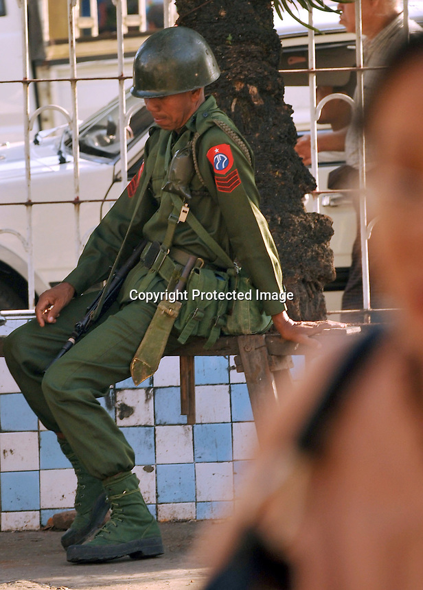 Armed police and soldiers guard a bridge in central Rangoon, Burma, Dec 2008.  The military remains prominent in every day life and guard all strategic points within the city.<br /> <br /> Photo by Richard Jones