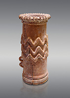 Minoan cylindrical cult vessel base used to support vessels full of offerings ,  1300-1100 BC,  Heraklion Archaeological  Museum, grey background .<br /> <br /> These cylindrical cult vessels were used until the Postpalatial period in the shrines of the godesses wth upraised arms