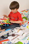 5 year old boy interested in airplanes, aviation and spacecraft looking at books and discussing features of airplanes