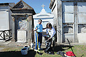 Tending the family tomb at St. Louis No. 2 Cemetery, 2014
