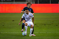 SAN JOSE, CA - SEPTEMBER 13: Sebastian Lletget #17 of the LA Galaxy protects the ball from Florian Jungwirth #23 of the San Jose Earthquakes during a game between Los Angeles Galaxy and San Jose Earthquakes at Earthquakes Stadium on September 13, 2020 in San Jose, California.