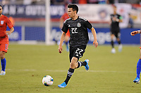 EAST RUTHERFORD, NJ - SEPTEMBER 7: Hirving Lozano #22 of Mexico kicks the ball during a game between Mexico and USMNT at MetLife Stadium on September 6, 2019 in East Rutherford, New Jersey.