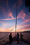 sunset aboard a beneteau 49 sailboat sailing the Charleston South Carolina Harbor during a beautiful night