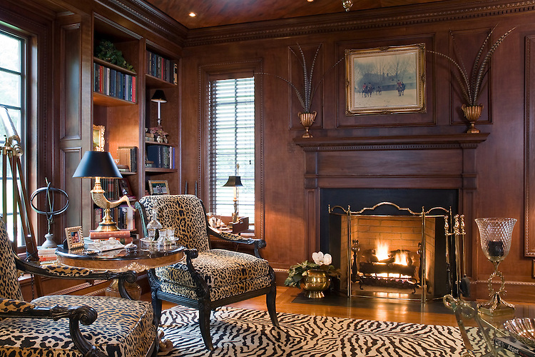 French Country Wood paneled Library with Zebra skin rug, leopard print upholstered chairs, antique accessories