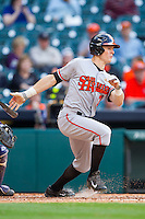 Hayden Simerly #7 of the Sam Houston State Bearkats follows through on his swing against the Texas Christian Horned Frogs at Minute Maid Park on February 28, 2014 in Houston, Texas.  The Bearkats defeated the Horned Frogs 9-4.  (Brian Westerholt/Four Seam Images)
