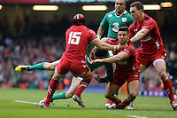 Pictured: Jared Payne of Ireland (C) is brought down by Rhys Webb (3rd L) and Leigh Halfpenny (15) of Wales Saturday 14 March 2015<br />