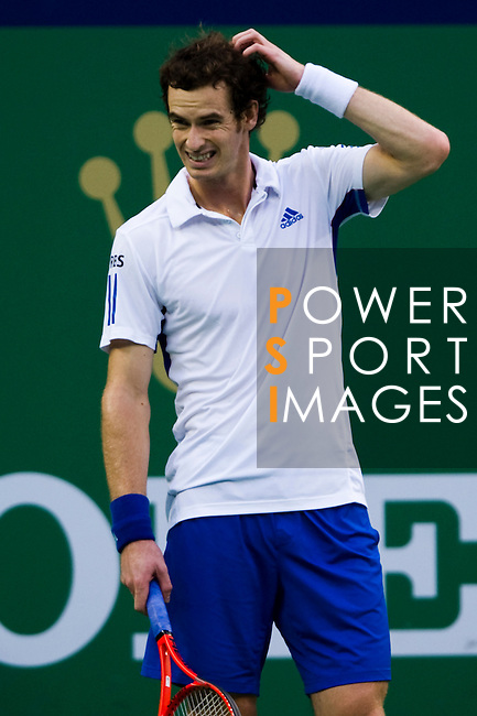 SHANGHAI, CHINA - OCTOBER 16:  Andy Murray of Great Britain reacts after loosing a point to Juan Monaco of Argentina during day six of the 2010 Shanghai Rolex Masters at the Shanghai Qi Zhong Tennis Center on October 16, 2010 in Shanghai, China.  (Photo by Victor Fraile/The Power of Sport Images) *** Local Caption *** Andy Murray