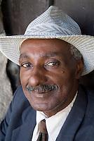 Portrait of a man wearing a vintage suit and fedora, Havana, Cuba.