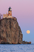"""""""Super Moonrise at Split Rock Lighthouse""""<br /> <br /> The December Full Cold Moon rose through a pastel palette on the eve of the Supermoon. Split Rock Lighthouse and Lake Superior helped paint a serene scene for the event."""