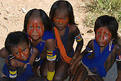 Pará State, Brazil. Aldeia Pukararankre (Kayapo). Four children with face and body paint and bead adornments.