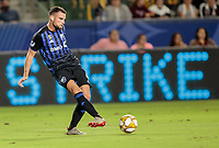 CARSON, CA - SEPTEMBER 21: Rudy Camacho #4 of Montreal Impact passes off a ball during a game between Montreal Impact and Los Angeles Galaxy at Dignity Health Sports Park on September 21, 2019 in Carson, California.