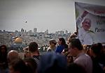 Christian pilgrims carry a banner of Pope Francis as they celebrate Palm Sunday in Jerusalem Sunday, April 13 2014. Photo by Eyal Warshavsky