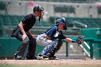 GCL Rays catcher Dawson Dimon (44) awaits a pitch in front of home plate umpire Mitch Trzeciak during a game against the GCL Red Sox on August 1, 2018 at JetBlue Park in Fort Myers, Florida.  GCL Red Sox defeated GCL Rays 5-1 in a rain shortened game.  (Mike Janes/Four Seam Images)