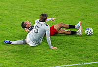 WASHINGTON, DC - NOVEMBER 8: Edison Flores #10 of D.C. United is tackled by Luis Binks #5 of the Montreal Impact during a game between Montreal Impact and D.C. United at Audi Field on November 8, 2020 in Washington, DC.