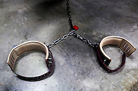 Chains in the TV room of Camp 6. Detainees are shackled to the floor while they watch TV at the American naval base at Guantanamo Bay, where over 600 alleged al Qaeda members have been held indefinitely. Described by the US as 'unlawful enemy combatants', they were captured primarily in Afghanistan during the 'war against terror'.