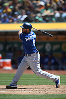 OAKLAND, CA - JUNE 9:  Mike Moustakas #8 of the Kansas City Royals bats against the Oakland Athletics during the game at the Oakland Coliseum on Saturday, June 9, 2018 in Oakland, California. (Photo by Brad Mangin)