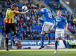 St Johnstone v Partick Thistle...28.09.13      SPFL<br /> Murray Davidson's heaeder is blocked by the hand of Aaron Muirhead but no penalty was awarded<br /> Picture by Graeme Hart.<br /> Copyright Perthshire Picture Agency<br /> Tel: 01738 623350  Mobile: 07990 594431