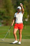 CHON BURI, THAILAND - FEBRUARY 18:  In Kyung Kim of South Korea celebrates on the 18th green during day two of the LPGA Thailand at Siam Country Club on February 18, 2011 in Chon Buri, Thailand. Photo by Victor Fraile / The Power of Sport Images