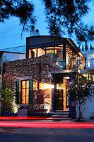 contemporary house with stone facade