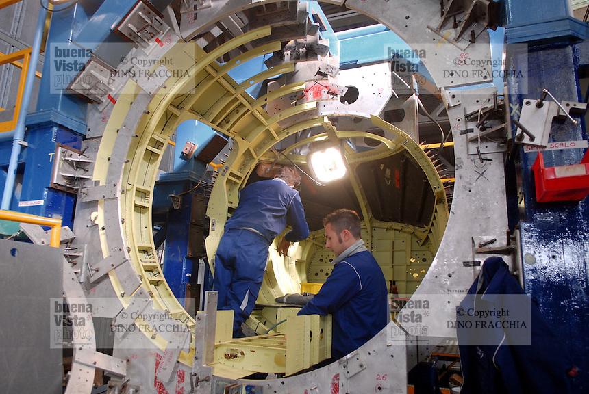 - Piaggio Aero plant, building of Avanti II business aircraft....- stabilimento Piaggio Aero, costruzione dell'aereo da trasporto privato Avanti II....