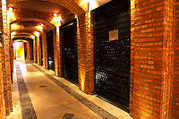 the brick bottle aging cellar with atmospheric lighting Bodega Familia Schroeder Winery, also called Saurus, Neuquen, Patagonia, Argentina, South America