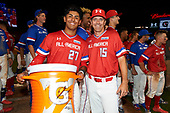 Kameron Ojeda (27) of St. John Bosco High School in La Mirada, California poses for a photo with Steve Bernhardt (15) after being named the recipient of the Gatorade G Award during the Under Armour All-American Game presented by Baseball Factory on July 29, 2017 at Wrigley Field in Chicago, Illinois.  (Mike Janes/Four Seam Images)
