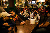 """A group of locals chilling out with their privately hired """"Trio"""" at Hussong´s cantina. <br /> <br /> In northern mexico bands known as """"trios"""" are well known for their services, private playings. In restaurants, bars or in the street is often see them offering songs, from traditional mexican music like mariachis, banda, corridos to classic rock."""