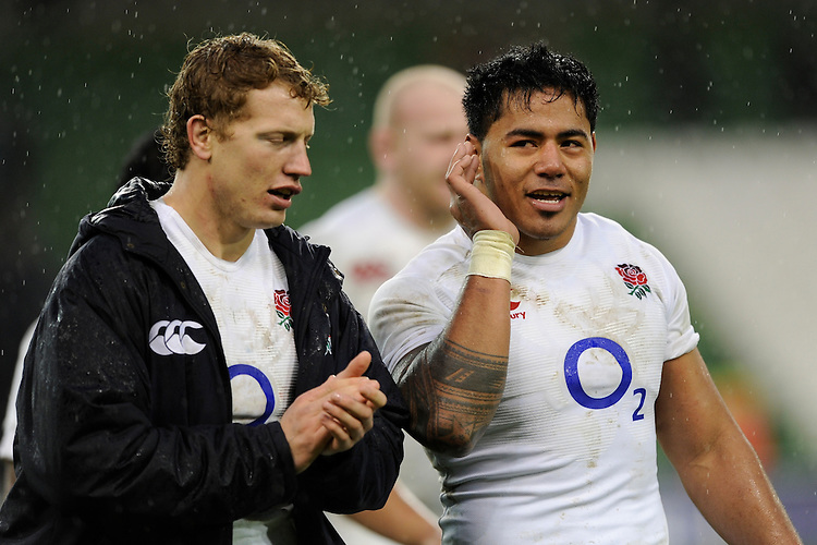 Manu Tuilagi of England (right) with team mate Billy Twelvetrees of England after winning the RBS 6 Nations match between Ireland and England at the Aviva Stadium, Dublin on Sunday 10 February 2013 (Photo by Rob Munro)