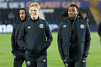 (L-R) Jan Zamburek and Josh Clarke of Brentford walk off the pitch prior to the Sky Bet Championship match between Swansea City and Brentford at the Liberty Stadium, Swansea, Wales, UK. Tuesday 22 October 2019