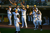 Bradenton Marauders players celebrate after scoring a run during Game Two of the Low-A Southeast Championship Series against the Tampa Tarpons on September 22, 2021 at LECOM Park in Bradenton, Florida.  (Mike Janes/Four Seam Images)