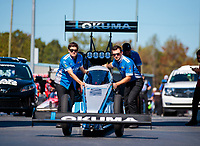 Oct 14, 2019; Concord, NC, USA; Crew members push the dragster of NHRA top fuel driver Leah Pritchett during the Carolina Nationals at zMax Dragway. Mandatory Credit: Mark J. Rebilas-USA TODAY Sports