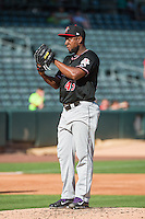 Albuquerque Isotopes starting pitcher Yohan Flande (45) looks to his catcher for the sign against the Salt Lake Bees in Pacific Coast League action at Smith's Ballpark on June 8, 2015 in Salt Lake City, Utah. The Bees defeated the Isotopes 10-7 in game one of a double-header. (Stephen Smith/Four Seam Images)