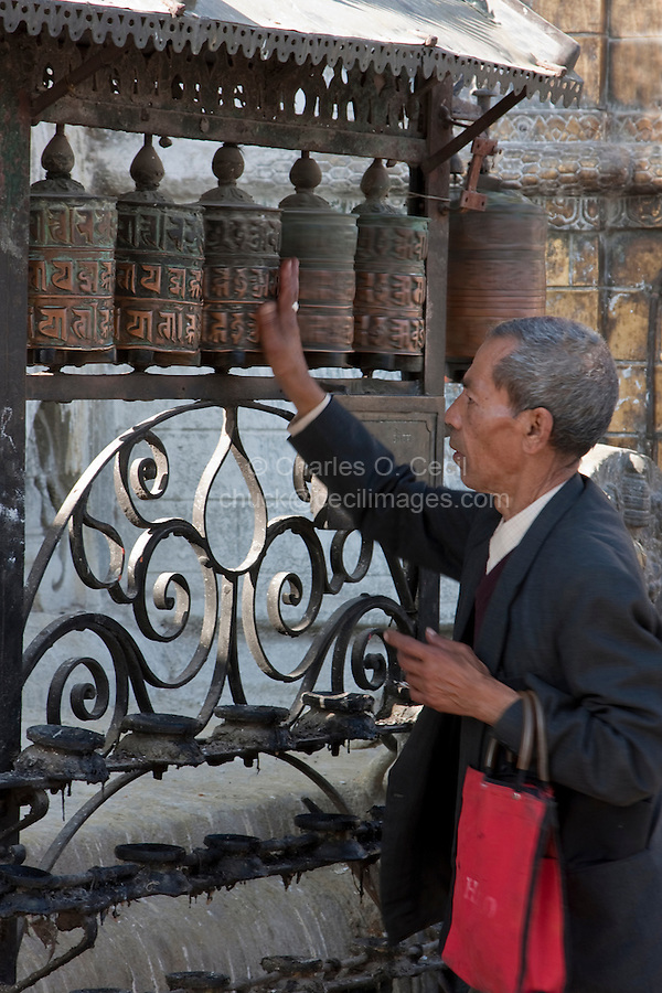 Kathmandu, Nepal.  May Spinning Prayer Wheels at Shrine, Swayambhunath Temple.