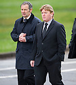 Motherwell manager Stuart McColl and assistant Kenny Black arrive at Mortonhall Crematorium for the funeral service of Sandy Jardine.