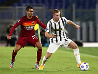 Football, Serie A: AS Roma - Juventus, Olympic stadium, Rome, September 27, 2020. <br /> Juventus' Delan Kulusevski (r) in action with Roma's Leonardo Spinazzola (l) during the Italian Serie A football match between Roma and Juventus at Olympic stadium in Rome, on September 27, 2020. <br /> UPDATE IMAGES PRESS/Isabella Bonotto