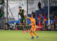 LAKE BUENA VISTA, FL - JULY 18: Eryk Williamson #30 of the Portland Timbers heads the ball as Memo Rodríguez #8 of the Houston Dynamo looks on during a game between Houston Dynamo and Portland Timbers at ESPN Wide World of Sports on July 18, 2020 in Lake Buena Vista, Florida.