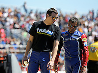 Mar. 16, 2013; Gainesville, FL, USA; NHRA pro stock motorcycle rider Hector Arana Sr (right) shows son Adam Arana the track conditions during qualifying for the Gatornationals at Auto-Plus Raceway at Gainesville. Mandatory Credit: Mark J. Rebilas-