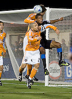 Ryan Johnson goes up for the header between two Dynamo players. San Jose Earthquakes defeated Houston Dynamo 3-2 at Buck Shaw Stadium in Santa Clara, California on March 28th, 2009.