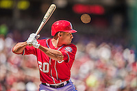 6 April 2014: Washington Nationals shortstop Ian Desmond at bat against the Atlanta Braves at Nationals Park in Washington, DC. The Nationals defeated the Braves 2-1 to salvage the last game of their 3-game series. Mandatory Credit: Ed Wolfstein Photo *** RAW (NEF) Image File Available ***