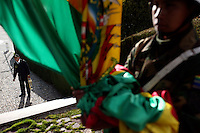 A Bolivian Navy officer raises the Bolivian flag at the naval base of San Pedro de Tiquina on the shores of Lake Titicaca. Bolivia lost what is now northern Chile in a war over nitrates leaving Bolivia without access to the ocean.
