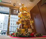 December 4, 2012, Tokyo, Japan - Japan jeweller Ginza Tanaka, which specializes in gold accessories, showcases their 2.4 meter high gold Christmas Tree in collaboration with Walt Disney Japan in commemoration of Walt Disney's 110th anniversary. The tree is made of 88 pounds of gold which consists of 50 popular Disney characters. The selling price is 350 million Japanese yen (approximately 4.2 million US dollars). The Christmas tree will be displayed at the Ginza Tanaka store until December 25. (Photo by Christopher Jue/Nippon News)