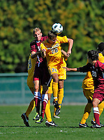 18 September 2011: University of Vermont Catamount Midfielder Noah Johnson, a Sophomore from Westford, VT, goes up against Harvard University Crimson Midfielder Tim Schmoll, a Freshman from Coppet, Switzerland at Centennial Field in Burlington, Vermont. The Catamounts defeated the visiting Crimson 1-0, earning their 3rd straight victory of the 2011 season. Mandatory Credit: Ed Wolfstein Photo